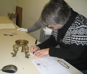 Registrar tagging a Bali artifact. Thanks to Sharon Steckline for the picture.