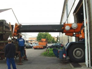 On the flat-bed trailer the machine didn't fit through our gate. The riggers had to be creative...