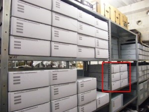 Shelves with repacked narrow film cameras and the six boxes with glass slides (marked red). You can also catch a glimpse of the now empty shelf boards.