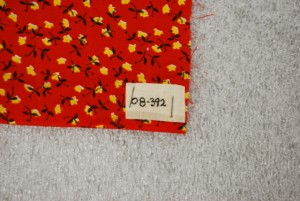 Another example of stapling the tag to the textile