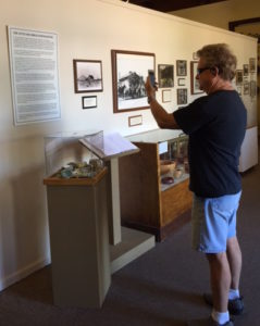 Chuck Dean demonstrates the use of the KNFB Reader app on his iPhone at the Scottsdale Historical Society Museum.