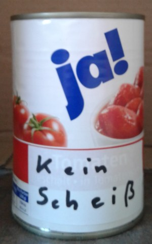 "The can reads ""no shit"" in German, thus avoiding copyright infringement. ""Kein Scheiß"" in Germany means both  ""no shit"" and ""I am not kidding you""."